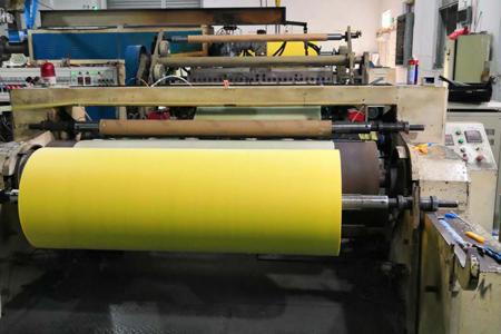 3. Compression of the two layers of non woven fabric while it is Cooling and make sure both layers can stick together closely. Rolling up the pressed non woven rolls and cut off the edges